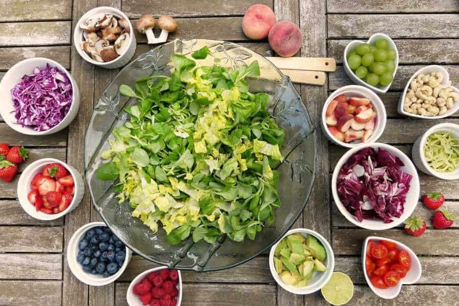 Salad in a glass bowl with various toppings for vegan and vegetarian meals in San Marcos Texas