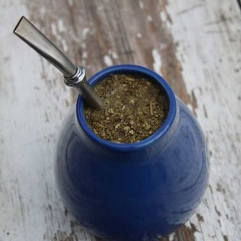 Traditional blue serving gourd and straw for yerba mate