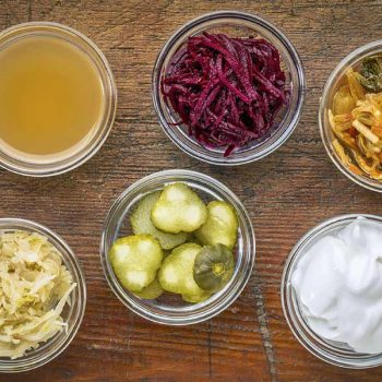 Cups of Probiotics are lined up on a table at a Frisco coffee shop.