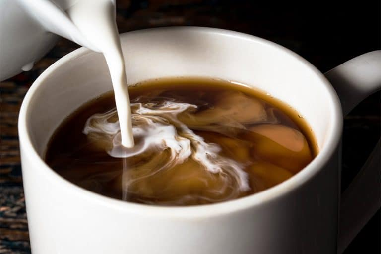 Creamer being poured in coffee