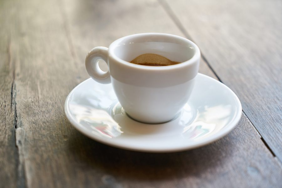 White cup of espresso on saucer