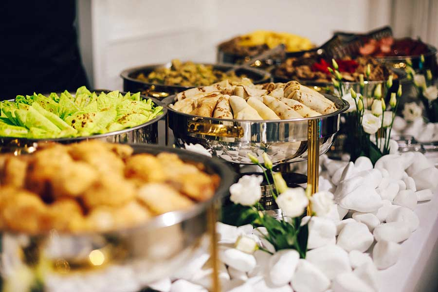 A buffet of catered food at an event