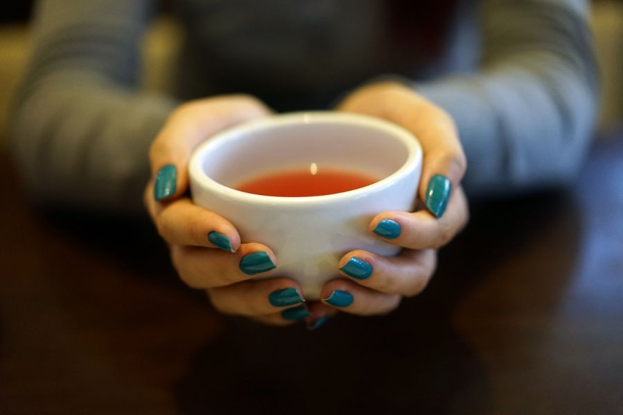 Cup of rooibos tea held in someone's hands